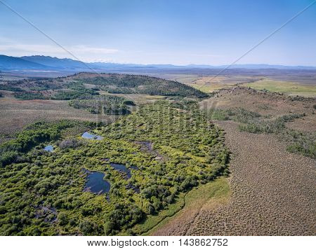 aerial view of Sherman Creek at foothills of Medicine Bow Mountains  in North park near Walden, Colorado