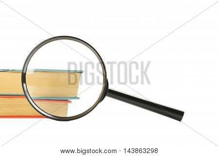 Magnifying Glass Wtih Books Isolated On A White