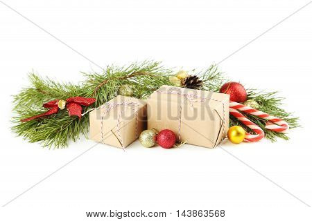 Christmax Tree Branch With Baubles, Gift Boxes And Candies On White Background