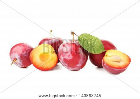 Fresh plums isolated on a white, close up