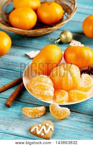 Ripe Mandarins With Gingerbread Cookies On A Blue Wooden Table