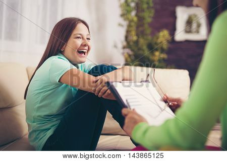 Girl teenager is happy after a successful therapy by psychologists