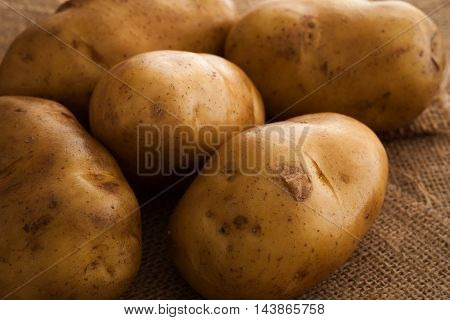 Potato Still Life On Sack Background