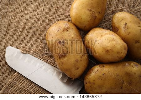 Potato On Still Life Sack Background