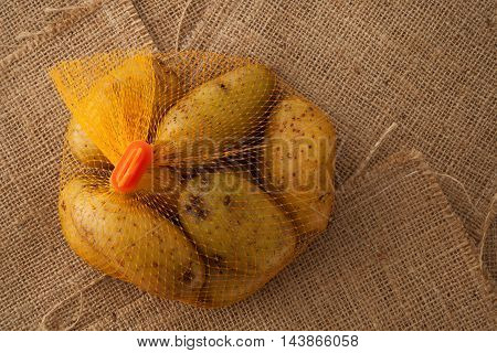 Potato Still Life On Sack Background Flat Lay