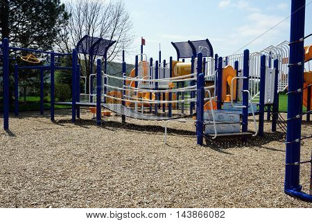 JOLIET, ILLINOIS / UNITED STATES - APRIL 22, 2016: A playground in Joliet, Illinois during the Spring.