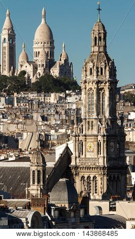 The Saint Trinity church and Sacre Coeur basilica in the background Paris; France.