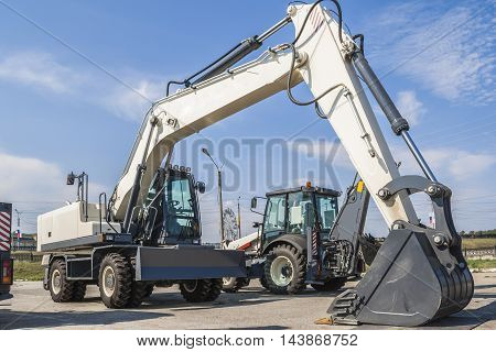 The New Excavator Is On The Road In The City