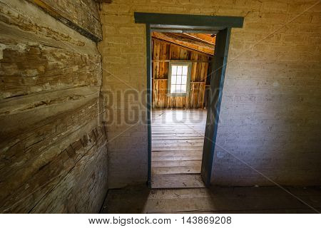 Interior View of Doorway and Window in Old Abandoned House