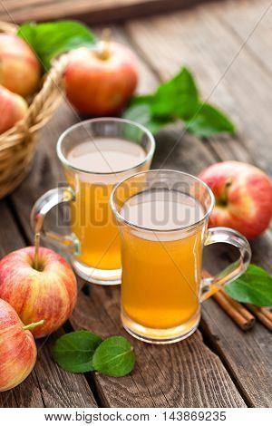 apple cider and fresh juicy fruits on wooden table