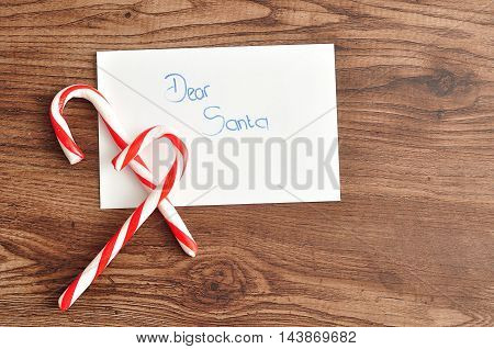 Two candy canes with a letter to Santa