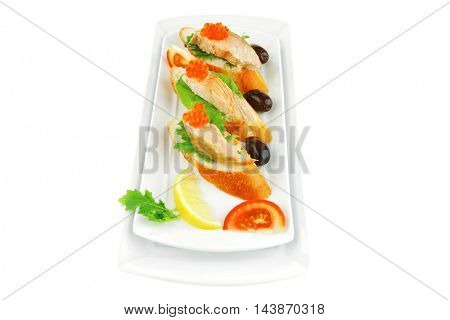 red salmon on baguette served with caviar