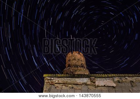 star trail in small city at night midnight