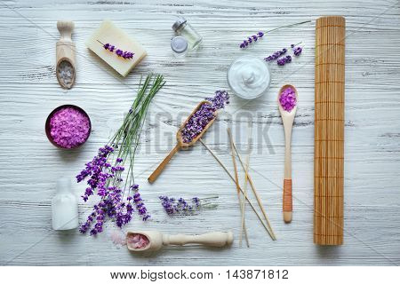 Spa composition with lavender on white wooden background