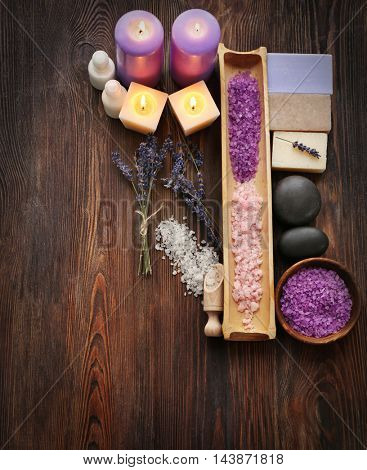 Spa composition with lavender, soap and salt on wooden background
