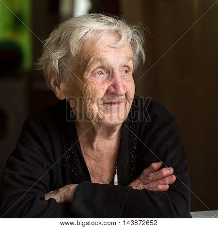 An elderly woman, closeup portrait.