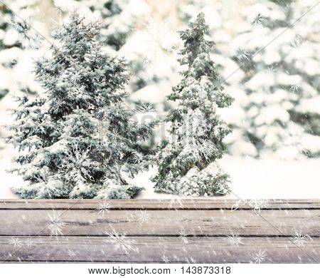 Wooden table on blurred winter background.
