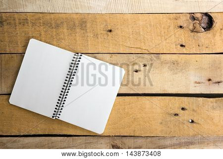 White blank paper notepad book at office worplace. Copy space.