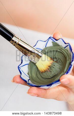 Skin Care. Closeup Of Brush And Clay Mud Mask.