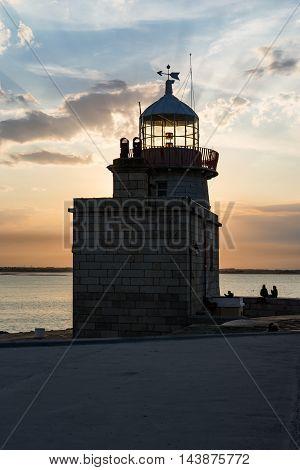 Warm Blue Orange Sunset Sky over Howth Lighthouse Tower Ireland