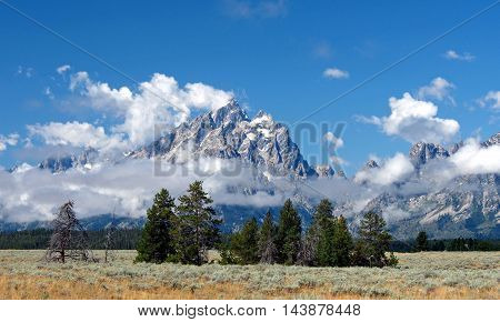 The Grand Teton Mountains with the clouds