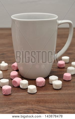 A mug with small white and pink marshmallow