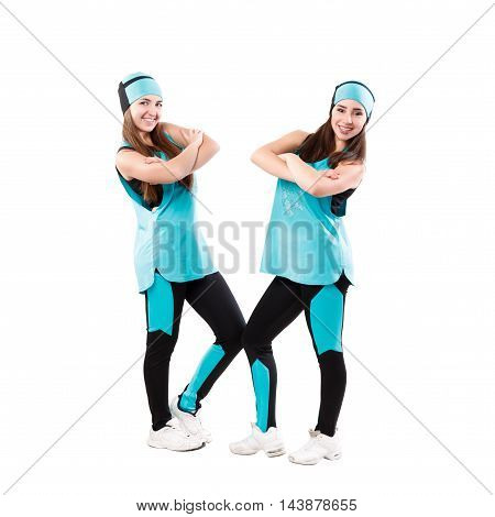 Two young professional cheerleaders posing at studio. Isolated over white.