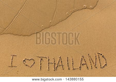 I Love Thailand - hand-written in the sand in the surf line.