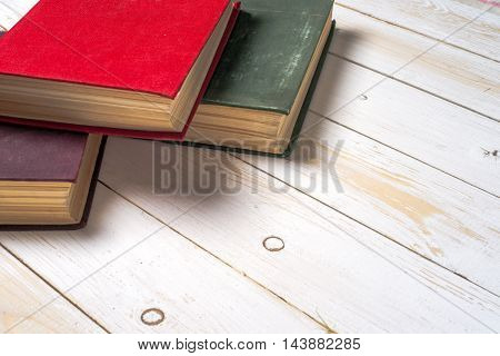 Top View Of Bright Colorful Hardback Books.