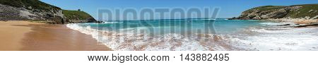 Beach With Beautiful Waves And Blue Sky, Landscape. North Spain. Panoramic Photo
