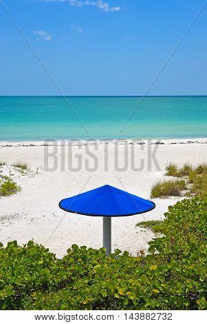 A Blue Beach Umbrella on the Sandy Beaches of Anna Maria Island Florida