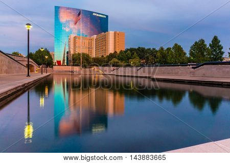 Indiananpolis Indiana USA- Auugust 17 2016. Reflection of moden hotel buildings in the Reflection pool in White River State Park Indianapolis Indiana.