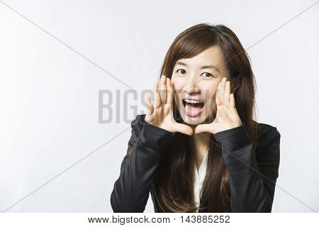 business woman shouting with white wall background