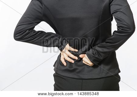 Business woman with back pain isolated over white background