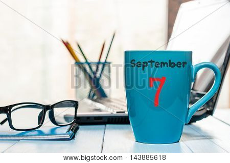 September 7th. Day 7 of month, wooden color calendar on chief workplace background. Autumn time. Empty space for text.