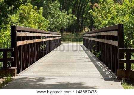 A foot bridge spanning a small river in Colorado.