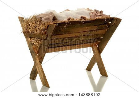 Manger with hay and fabrics isolated over white background