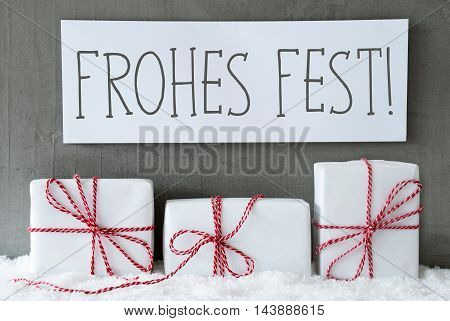 Label With German Text Frohes Fest Means Merry ChristmasThree Christmas Gifts Or Presents On Snow. Cement Wall As Background. Modern And Urban Style. Card For Birthday Or Seasons Greetings.