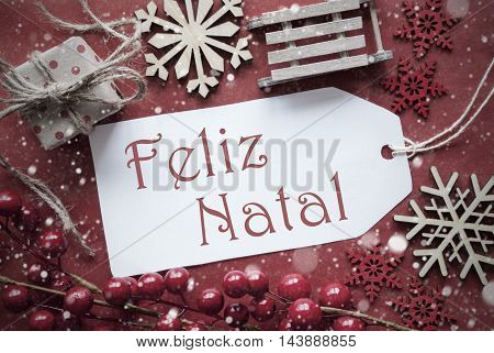 Nostalgic Christmas Decoration Like Gift Or Present, Sleigh. Card For Seasons Greetings With Red Paper Background. Portuguese Text Feliz Natal Means Merry Christmas