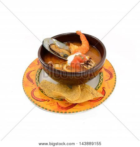 Mexican style of seafood soup with shrimp salmon and clams in black bowl