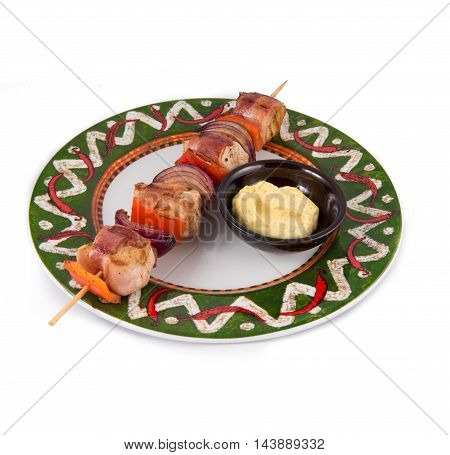 Grilled dishes with meat skewer and sauce on white plate in mexian style