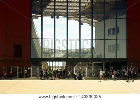 MAINZ, GERMANY - AUGUST 06: Fans in front of the entrance of the Opel Arena going to the friendly match between Liverpool FC and 1. FSV Mainz 05 on August 06, 2016 in Mainz.