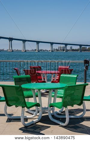 red and green round tables with chairs