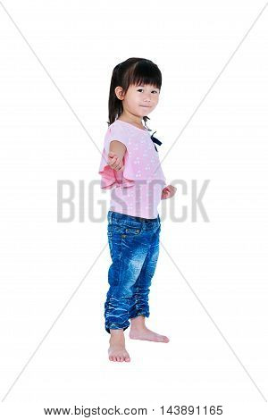 Full body of happy asian child posing in the studio isolated on white background. Playful girl smiling and looking at camera. Studio shot.