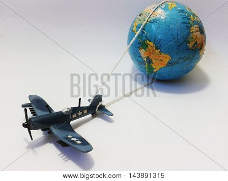 Nueva Esparta, Venezuela 21 august 2016. A litle model airplane tied and carryin a litle world globe