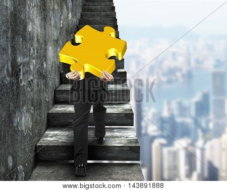 Businessman Carrying Gold Puzzle Piece Climbing On Old Stairs