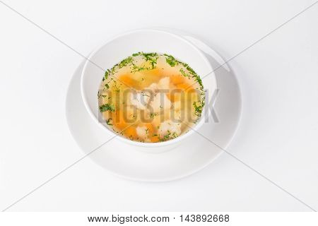 Soup of the Lake walleye with fish and carrot in white bowl