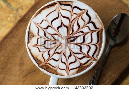 a picture of a cup of coffee cappuccino perfectly arranged. Exceptional image of rare beauty