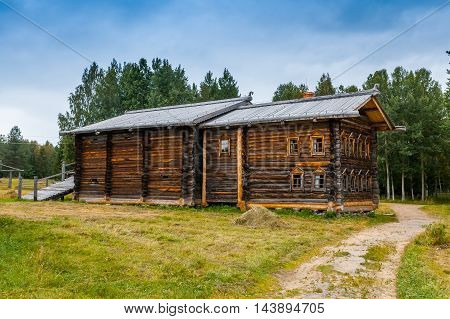 Old north Russian house with two floors. Rear view.
