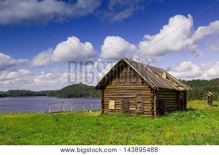 Old north Russian house on the lake shore.